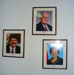 Framed photos of AFL-CIO officers at Solidarity Center in Bangkok